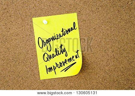 Organizational Quality Improvement Written On Yellow Paper Note