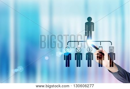 Businesswoman hand pointing at delegating pictogram on blue background