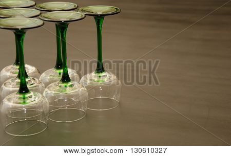 Six Classic Green Stemmed Wine Glasses Overturned in a Triangular Fashion