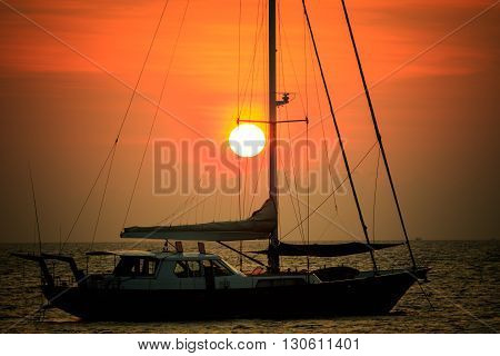 beautiful natural scenic of sun set behind sailing boat