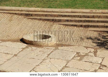 An open well just outside Old Jerusalem City walls in Jerusalem, Israel.