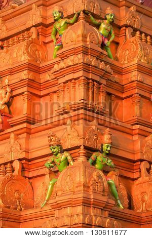 Hindu temple with sculpture on exterior wall