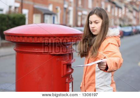 Girl Posting Letter To Letterbox