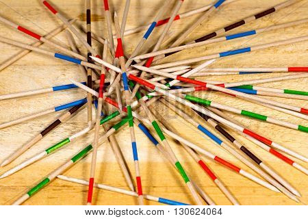 Detail of wooden sticks of the game of Mikado or Shanghai on a wooden table