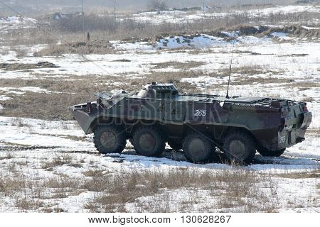 Zhitomir Ukraine - March 10 2011: Armored personnel carrier BTR-80 during the military trainings in snow