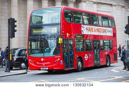 LONDON, UK - OCTOBER 14, 2015. Red British bus by the Bank of England