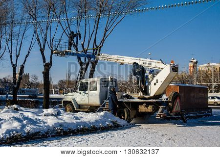 Volgograd, Russia - January 22 2012: Workers decorate the trees on the Ploshhad' Pavshih Borcov (the Square of the Fallen Fighters) in Volgograd