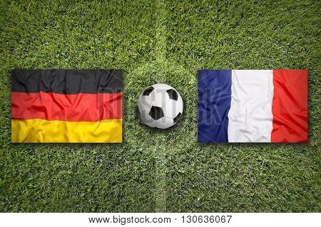 Germany Vs. France Flags On Soccer Field