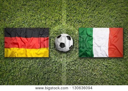 Germany Vs. Italy Flags On Soccer Field