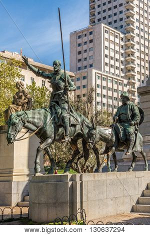 MADRID,SPAIN - APRIL 25,2016 - Cervantes Memorial with statues Don Quixote and Sancho Panza. Square of Spain is a large square and popular tourist destination located in central Madrid.