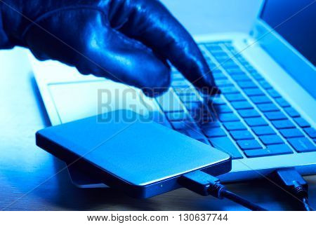 Cyber Criminal Downloading Data Onto Portable Hard Drive