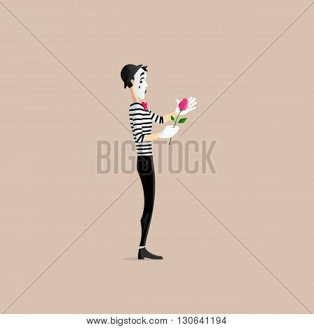 A Mime performing a pantomime covering a flower - a red rose