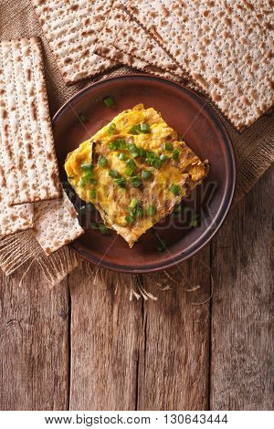 Matzah Brei With Green Onions Close-up On A Plate. Vertical Top View