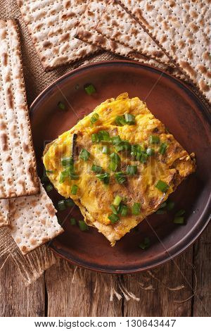 Jewish Breakfast: Matzah Brei With Green Onions Close-up. Vertical Top View