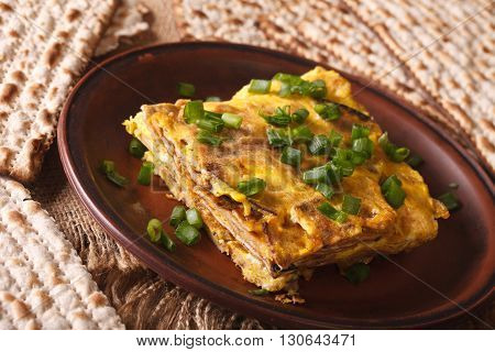 Jewish Cuisine: Matzah Brei With Green Onions Close-up. Horizontal