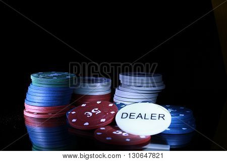 gambling chips on the black background casino
