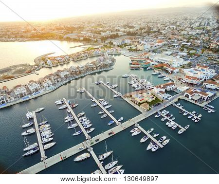 Aerial view of the beautiful Marina in Limassol city in Cyprus,beach,boats,piers,villas and commercial area.A modern,high end,newly developed space with docked yachts and for a waterfront promenade.