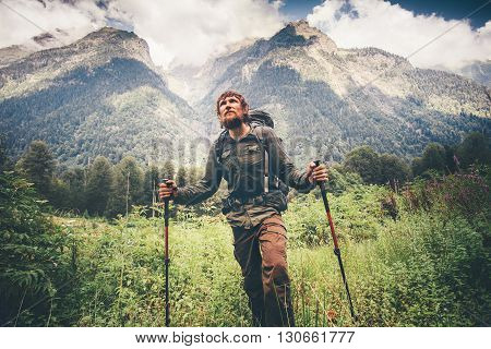 Traveler Man with backpack mountaineering Travel Lifestyle concept beautiful mountains with clouds sky landscape on background adventure vacations outdoor