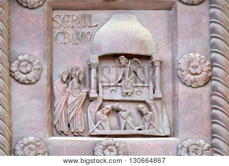 PISA, ITALY - JUNE 06, 2015: Resurrection of Christ on the San Ranieri gate of the Cathedral St. Mary of the Assumption in Pisa, Italy on June 06, 2015
