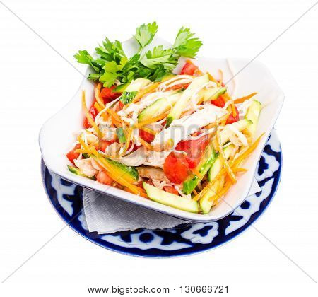 Chinese chicken salad with cucumber and tomatoes. Isolated on a white background.