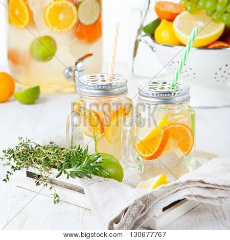 Detox fruit infused flavored water. Refreshing summer homemade lemonade cocktail Cleanse body and burn fat poster