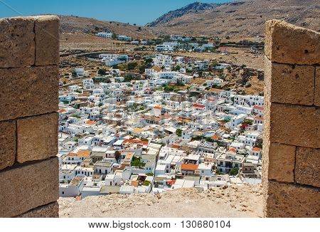 view of ancient city of Lindos by loophole ancient fortress