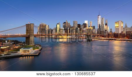 Aerial view of the Brooklyn Bridge at sunrise and Manhattan Lower East Side Financial District. New York City