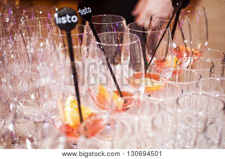 Party drinks preparation fresh coctails with orange liqueur