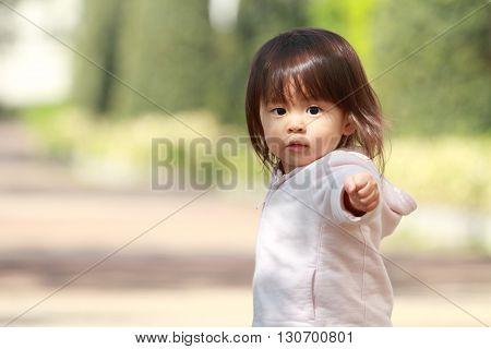 Japanese girl taking a walk (1 year old)