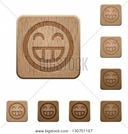 Set of carved wooden Laughing emoticon buttons in 8 variations.