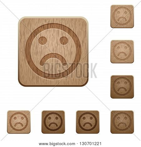 Set of carved wooden sad emoticon buttons in 8 variations.