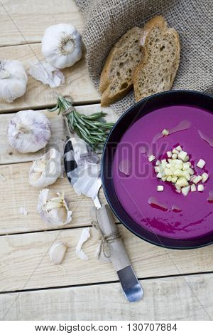 Cold Red Beet Soup And Ginger. Garlic, Rye Baguette And Rosemary Are Next On The Background.