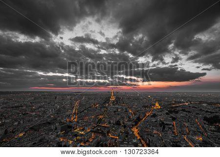 Paris, France at sunset. Aerial view on the Eiffel Tower, Arc de Triomphe, Les Invalides etc.
