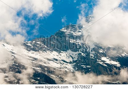 Eiger, Swiss Alps - snow capped mountains and deep valleys stunning view breath-taking panorama