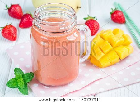 Healthy smoothie with strawberry, mango and banana