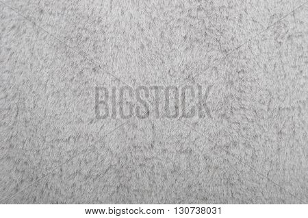 Close up of gray synthetical fur textured background