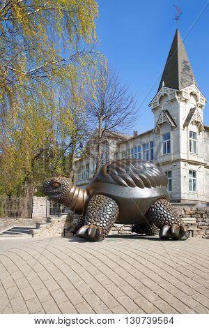 JURMALA, LATVIA - MAY 02, 2014: The sculpture of a large turtle on a spring day. Landmark of the city Jurmala, Latvia