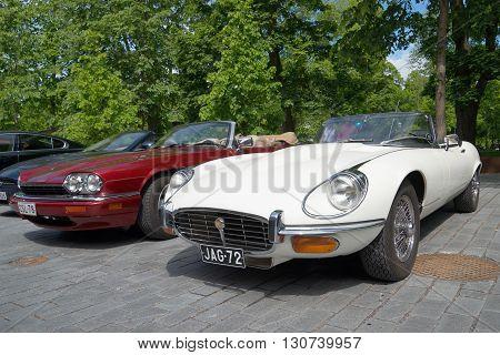 TURKU, FINLAND - JUNE 13, 2015: White Jaguar E XKE Series 3 and red Jaguar XJ-S (XJS) on the parade car brand