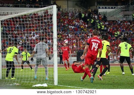 July 24, 2015- Shah Alam, Malaysia: Liverpool's players (red) attacks the Malaysian goal in the friendly match against the Malaysian team. Liverpool Football Club from England is on an Asia tour.
