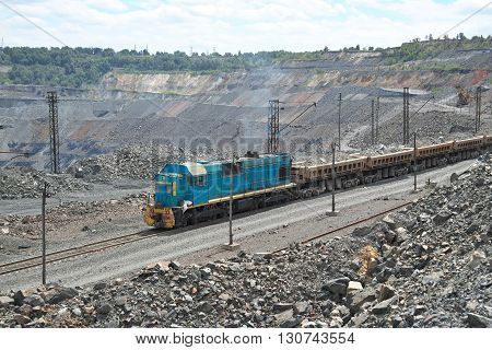 Train delivering iron ore on the iron ore opencast mining