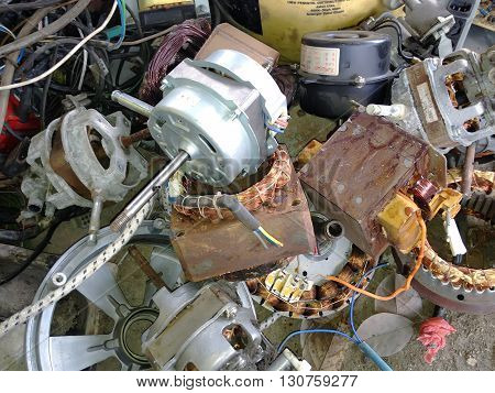 KLANG MALAYSIA - MAY 21 2016: Used components of table fan and other stuffs has disassembled for recycling purposes at junkyard or scrapyard.
