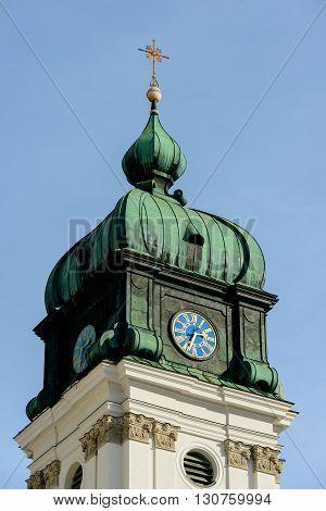 Clocktower of Ettal Abbey a Benedictine monastery in the village of Ettal in Bavaria Germany in winter.