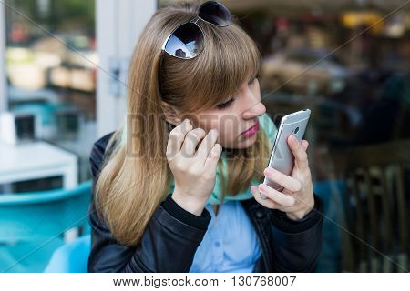 Young Woman Making Self Portrait Using Smartphone