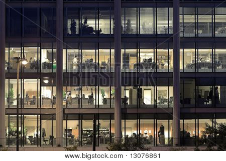 Late night overtime in a modern office building.