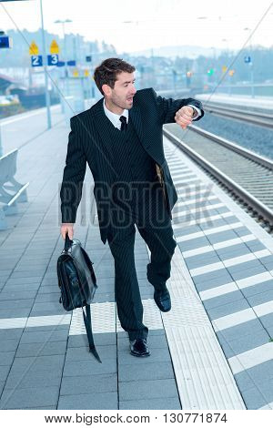 Businessman On Railroad Station In Hastiness