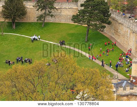 LINCOLN ENGLAND - MAY 3: Parties of visiting schoolchildren within the walls of Lincoln Castle. Lincoln England. On 3rd May 2016.