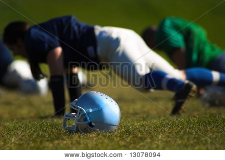 Football players are doing training. poster