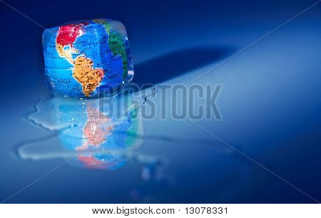 Conceptual image about saving Earth. The globe  frozen into an icecube thawing.