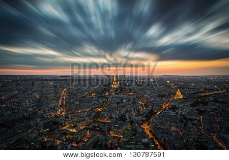 PARIS, FRANCE - May 18, 2016: Beautiful view of illuminated Eiffel tower, the city and a dramatic sky, Paris, France