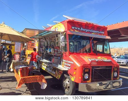 PHOENIX AZ - FEBRUARY 5 2016: Lunch for meal from Burgers Amore food truck at designated outdoor spot in downtown of Phoenix AZ
